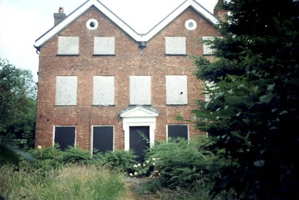 An Artful Gardener Astley Old Vicarage front view - doors and windows boarded up circa 1992